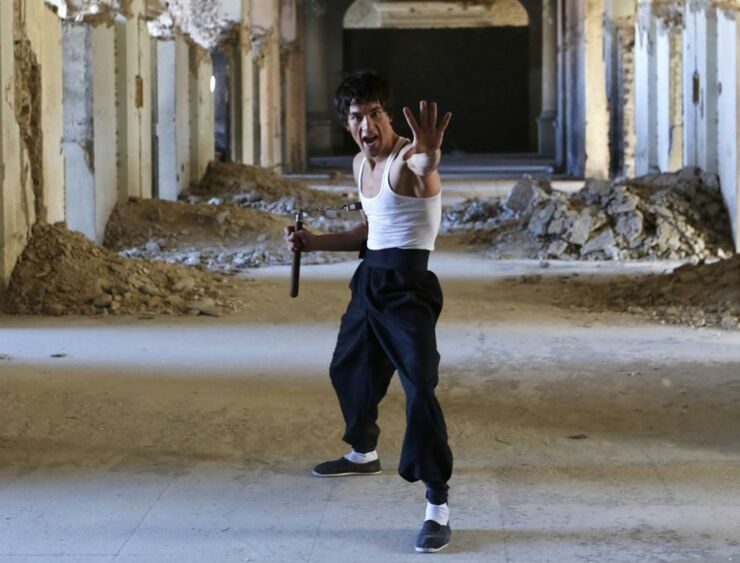 Abbas Alizada, who calls himself the Afghan Bruce Lee, poses for the media in Kabul.