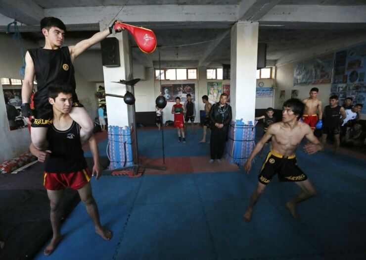 Abbas Alizada, who calls himself the Afghan Bruce Lee, works out during a media event in Kabul.