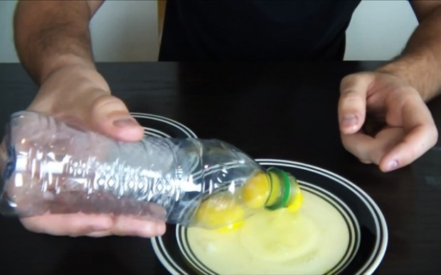 Place a plastic bottle on top of a yoke and gently squeeze to separate egg yolks from egg whites (41 of 50)