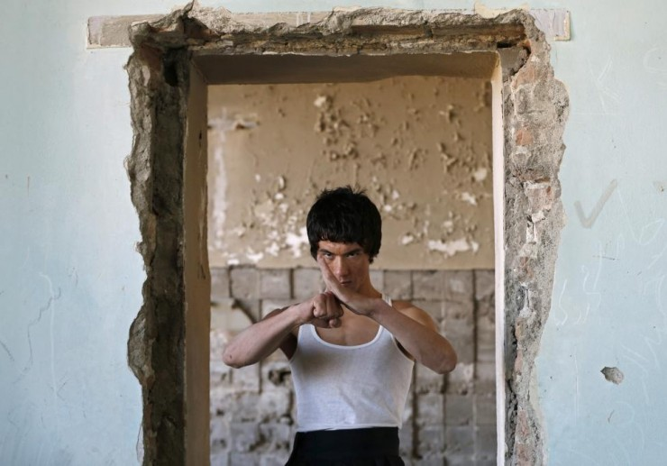Abbas Alizada, who calls himself the Afghan Bruce Lee, poses during a media event in Kabul.